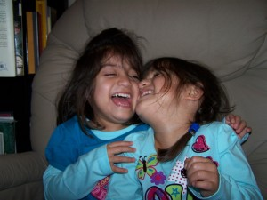 Cheek-to-cheek, these sisters are oozing joy, laughter and closeness.